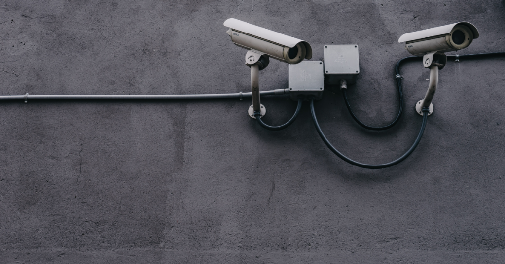 CCTV cameras mounted on a grey wall