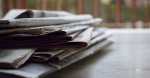 image shows a pile of newspapers